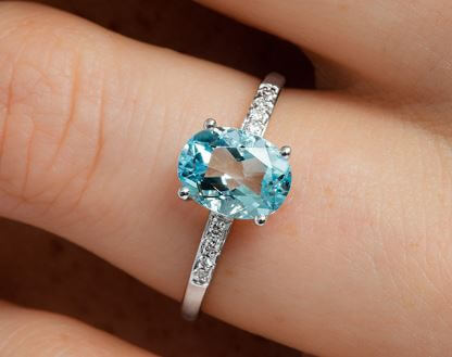 An aquamarine engagement ring